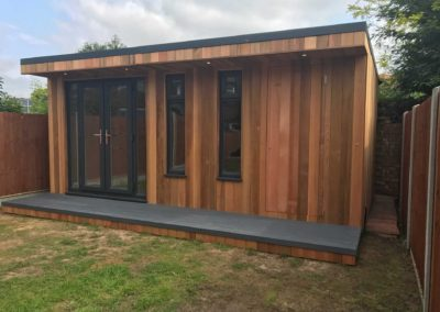 Garden room with double doors and side storage entrance