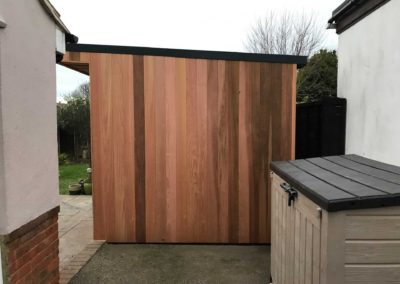 Side of garden room next to outside storage