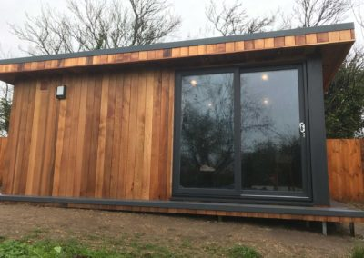 Garden room with corner sliding door