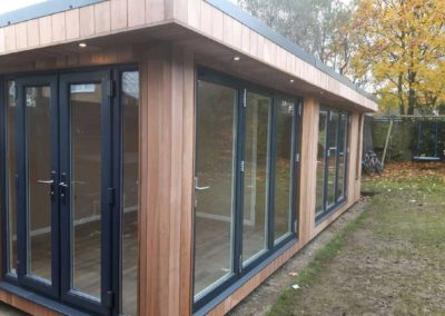 Garden room with multiple entrances and large windows