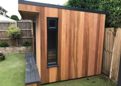Side of garden room with hanging plant pot