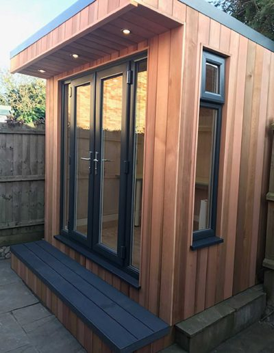 Garden room with double doors on concrete base