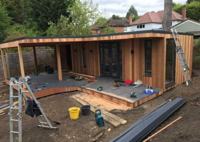 Large garden room with large grey deck under construction