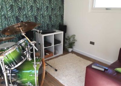 Inside garden music room with drum kit