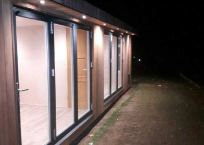 Garden room with lights on