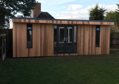 Large garden room next to fence