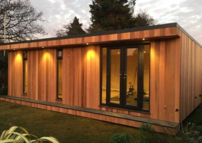 Side angle view of large garden room showing spotlights in use