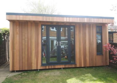 Garden room with double door and vertical window