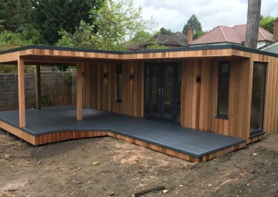 Large garden room with large grey deck and canopy