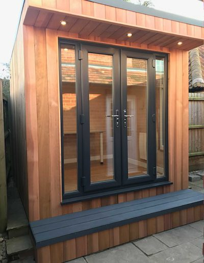 Garden room with step deck on concrete base