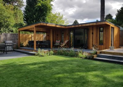 Large garden room with sliding doors and grey deck