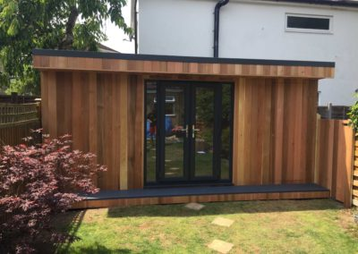 garden room with red bush
