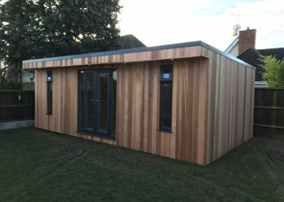 Angled view of large garden room with grass