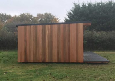 Left side of large garden room with grey deck