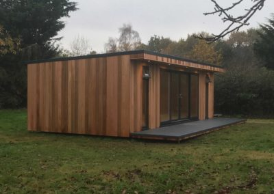 Angled left side of large garden room with deck