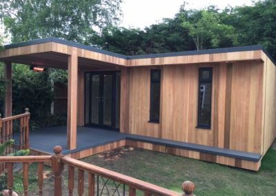 Angled garden room with grey deck and narrow vertical windows