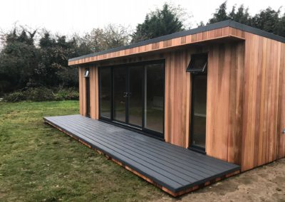 Front right angled large garden room with large windows