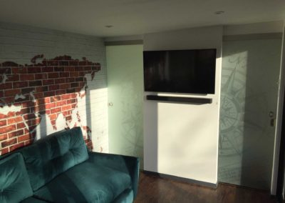 Inside garden room with wall mounted TV