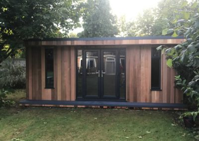 Front of garden room with grey double doors and deck